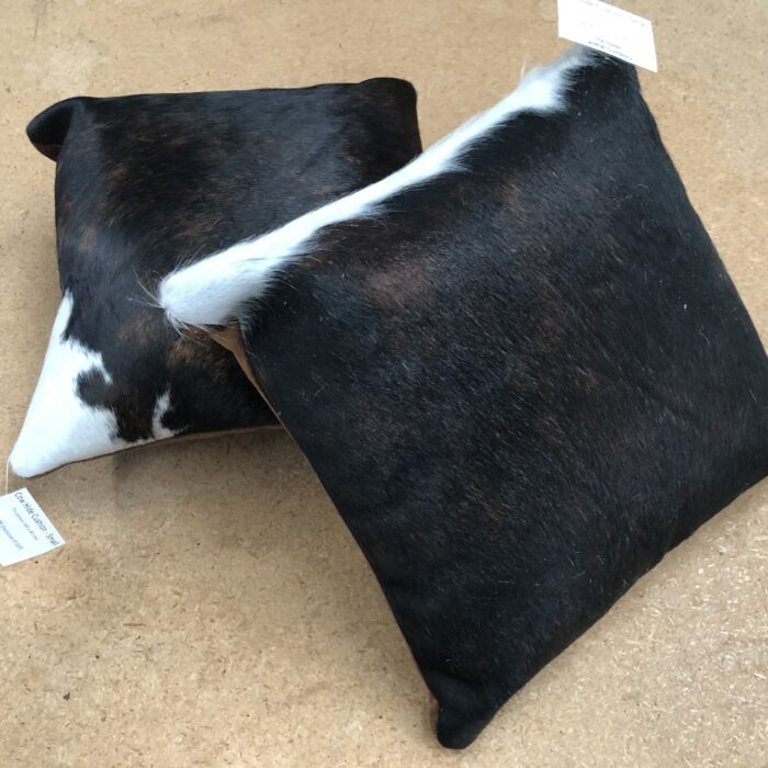 Tri-colour cowhide cushion